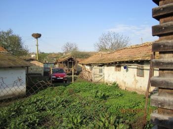 Key Features: .The property is located in center of the village .Accessible through all season via tarmac road .Property with 2315 sq.m of land .Solid house/solid garage .4 bedrooms .there is smaler summer kitchen .water and electricity are connected to mains .near village is forest